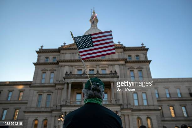"Protesters attend a ""Count On Us"" rally at the Michigan State Capitol building on November 04, 2020 in Lansing, Michigan. People gathered to demand..."