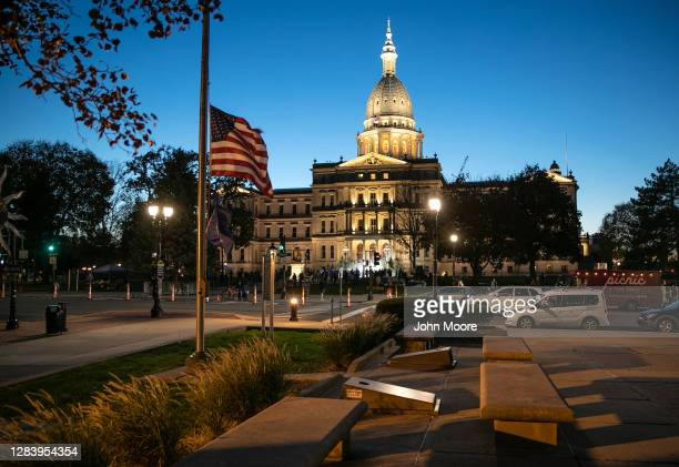 "Protesters attend a ""Count On Us"" rally on the steps of the Michigan State Capitol building on November 04, 2020 in Lansing, Michigan. People..."