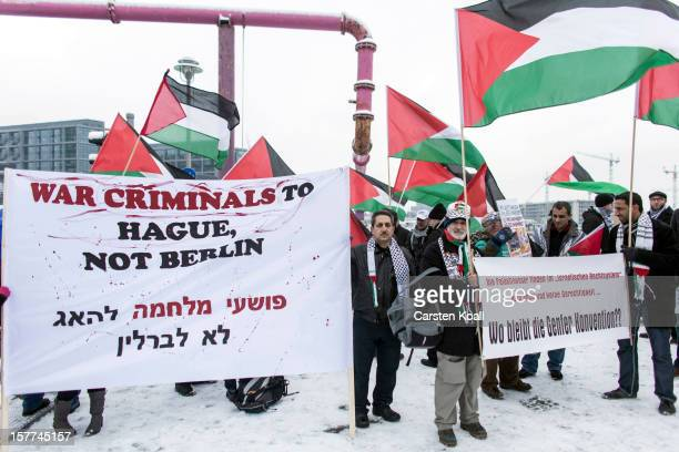Protesters attend a demonstration organized by expat Palestinians against the visit of Israeli Prime Minister Benjamin Netanyahu near the Chancellery...