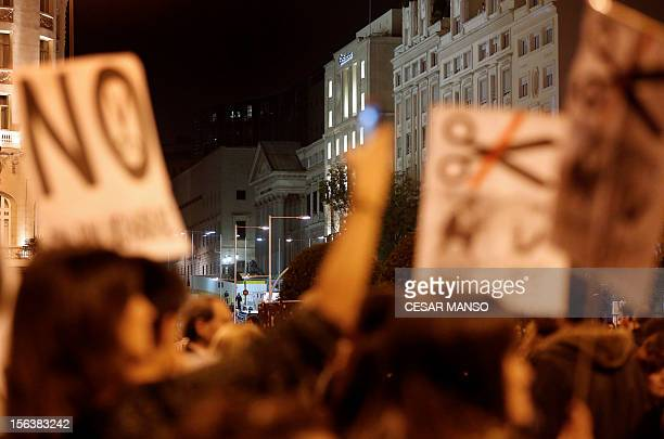 "Protesters attend a demonstration organized by Spain's ""indignant"" protesters, a popular movement against a political system that they say deprives..."