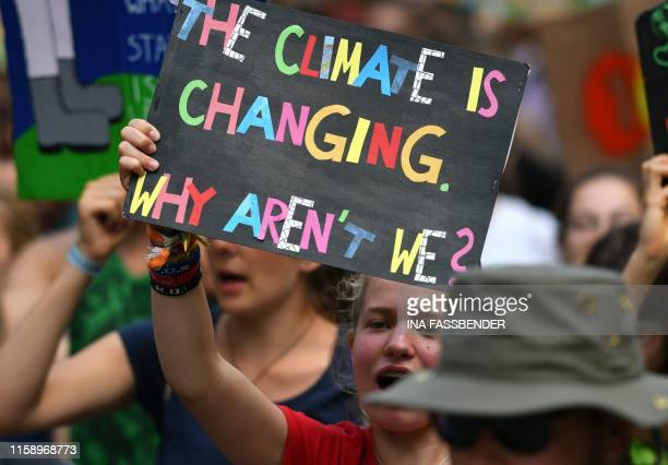 Protesters attend a Fridays For Future demonstration for climate protection that is part of a Summer congress in Dortmund western Germany on August 2...