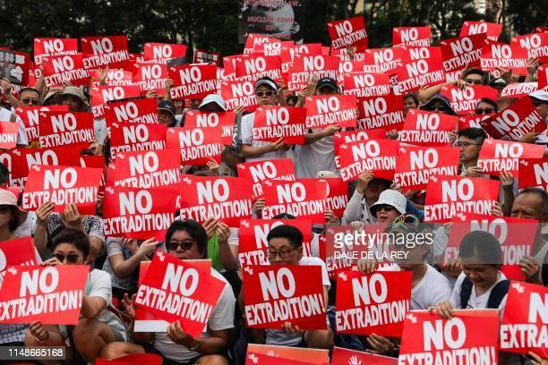 TOPSHOT Protesters attend a rally against a controversial extradition law proposal in Hong Kong on June 9 2019 The city's proBeijing government is...