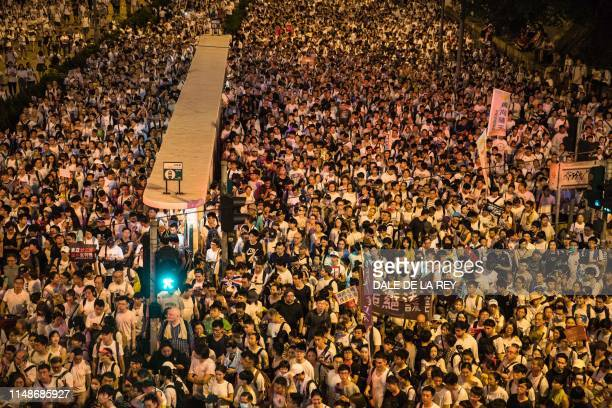 TOPSHOT Protesters attend a rally against a controversial extradition law proposal in Hong Kong on June 9 2019 Hong Kong witnessed its largest street...