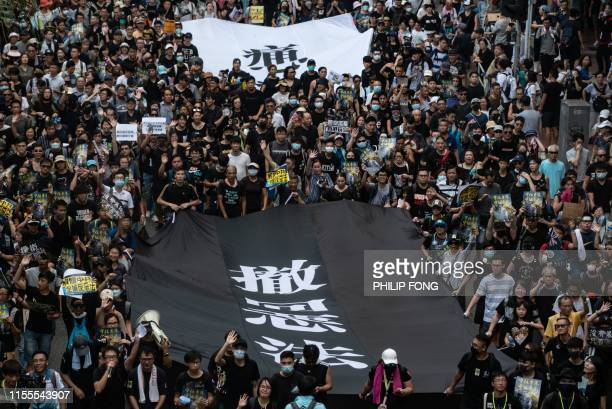 TOPSHOT Protesters attend a rally against a controversial extradition law proposal in Sha Tin district of Hong Kong on July 14 2019