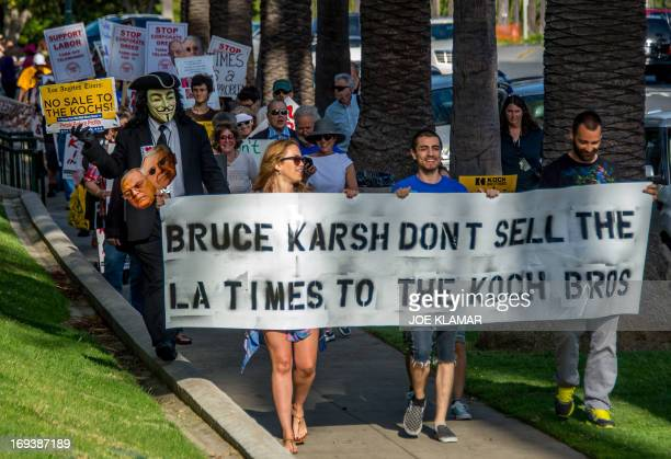 Protesters attend a rally and march asking Los Angeles Times owner Bruce Karsh the billionaire president of Oaktree Capital Management not to sell...