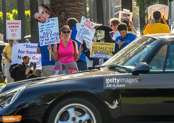 Protesters attend a rally and march demanding Los Angeles Times not be sold to the Koch Brothers May 23 2013 in Beverly Hills California Charles and...
