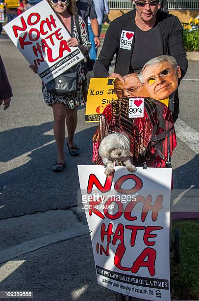 Protesters attend a rally and march demanding the Los Angeles Times not be sold to the Koch Brothers May 23 2013 in Beverly Hills California Charles...