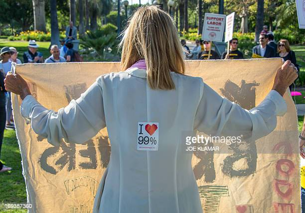 Protesters attend a rally and march urging the Los Angeles Times not be sold to the Koch Brothers May 23 2013 in Beverly Hills California Charles and...
