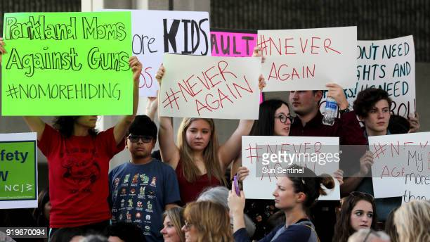 Protesters attend a rally at the Federal Courthouse in Fort Lauderdale Fla to demand government action on firearms on Saturday Feb 17 2018 Their call...