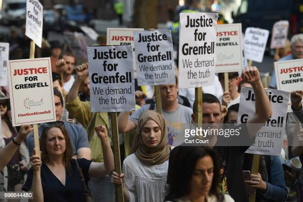 Protesters attend a rally calling for justice for those affected by the Grenfell Tower fire outside the Department for Communities Local Government...