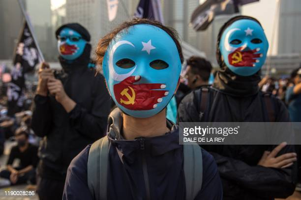 TOPSHOT Protesters attend a rally in Hong Kong on December 22 2019 to show support for the Uighur minority in China ong Kong riot police broke up a...