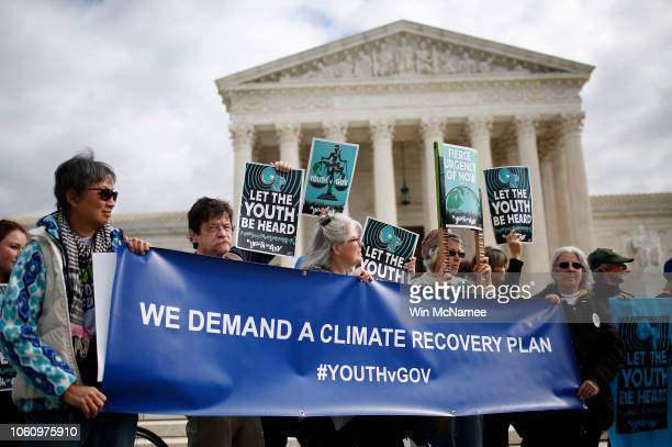 Protesters attend a rally outside the US Supreme Court held by the group Our Children's Trust October 29 2018 in Washington DC The group rallied in...