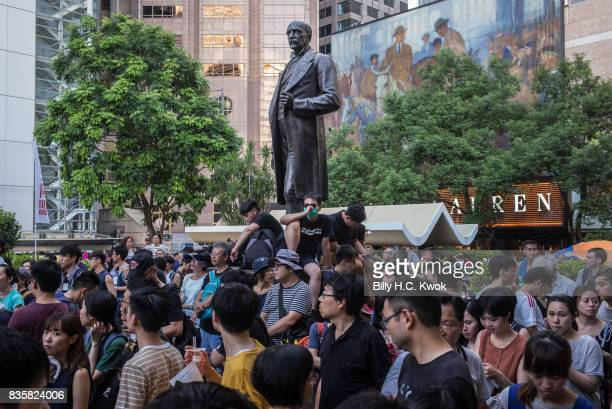 Protesters attend a rally to support young activists Joshua Wong, Nathan Law and Alex Chow in central on August 20, 2017 in Hong Kong, Hong Kong....