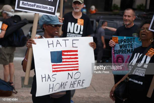 Protesters attend the Unite Against Hate rally in Freedom Plaza along Pennsylvania Avenue ahead of a planned white supremacist event near the White...