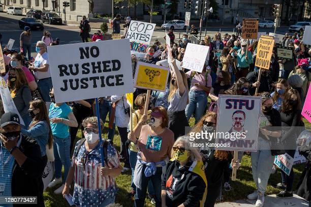 Protesters attend the Women's March at Freedom Plaza on October 17, 2020 in Washington, DC. Demonstrators took to the streets in honor of the late...