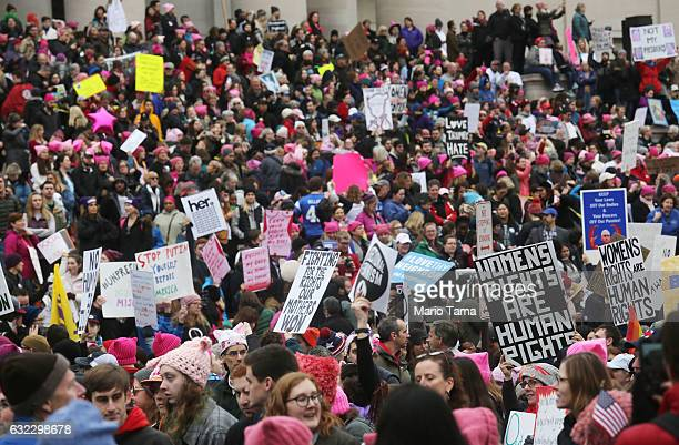Protesters attend the Women's March on Washington on January 21, 2017 in Washington, DC. Large crowds are attending the anti-Trump rally a day after...