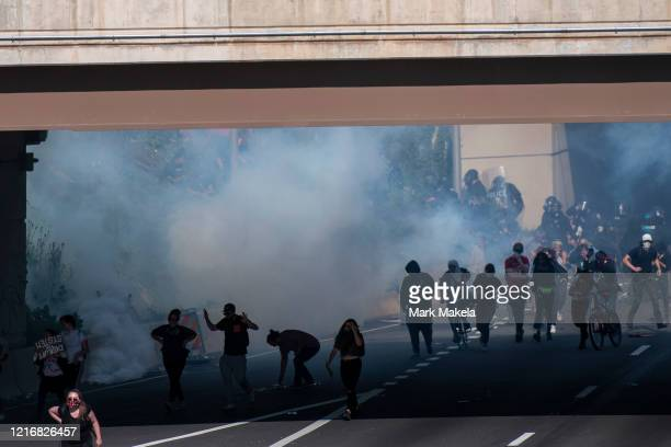 Protesters away from tear gas after a march through Center City on June 1 2020 in Philadelphia Pennsylvania Demonstrations have erupted all across...