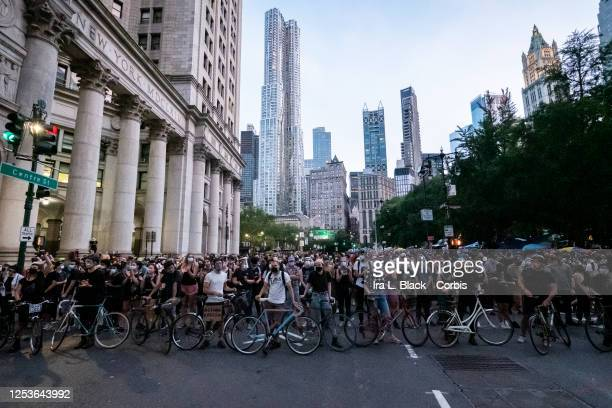 Protesters barricade the street with bikes and hundreds of people at City Hall Manhattan Earlier in the day one of the members of Warriors in the...