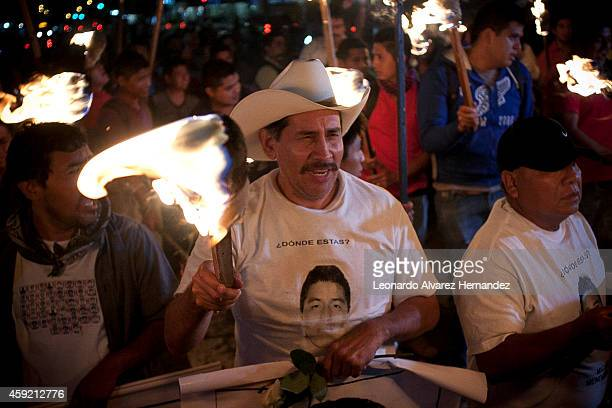 Protesters belonging to the Caravan of relatives and students of the Rural School Raúl Isidro Burgos arrive to Guadalajara demanding justice for the...