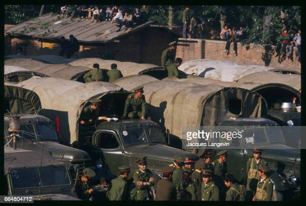 Protesters block a military convoy that is on its way to break up a student hunger strike in Beijing's Tiananmen Square In the spring of 1989...