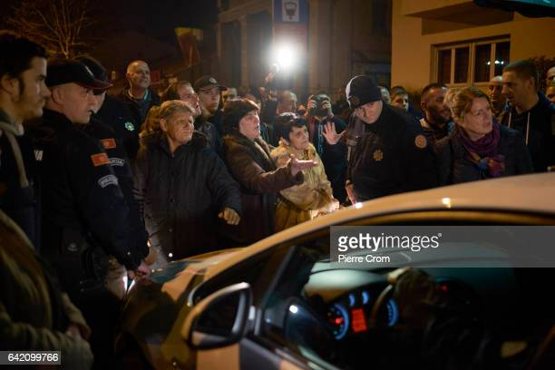 Protesters block a police vehicle after officers seized blankets at a rally against the social policy of the government on February 16 2017 in...