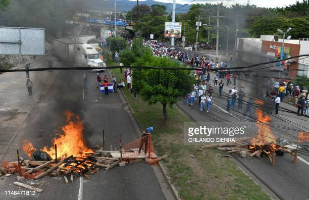 Protesters block a road during a teachers and medical doctors protest in the surroundings of the presidential palace in Tegucigalpa on May 27 2019...