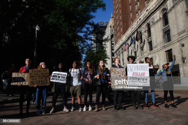 Protesters block an intersection a day after the funeral of Antwon Rose II on June 26 2018 in Downtown Pittsburgh Pennsylvania Rose was killed by an...