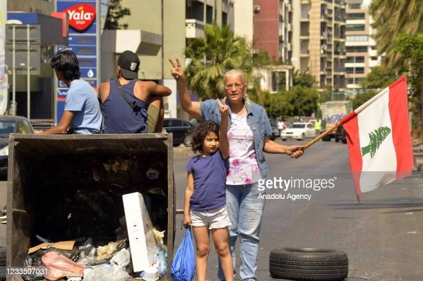 """Protesters block roads with tyres and garbage containers during a protest demanding """"recovery government"""" as part of a 24-hour general strike against..."""