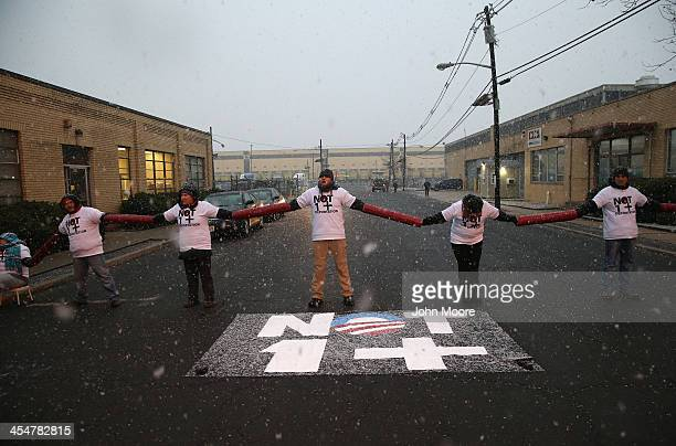 Protesters block the entrance of an immigrant detention center on December 10 2013 in Elizabeth New Jersey A coalition of immigrant advocacy groups...