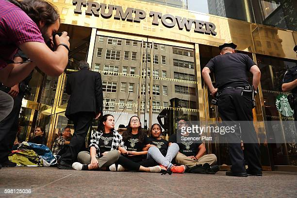Protesters block the entrance to Trump Tower in Manhattan before being arrested on August 31 2016 in New York City The action called 'hecho por...