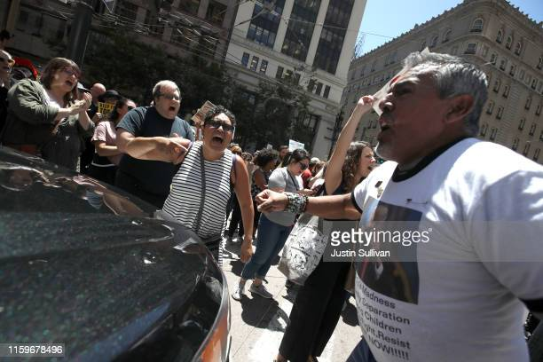 Protesters block traffic during a demonstration in front of US Sen Dianne Feinstein's office against migrant detention facilities on July 02 2019 in...