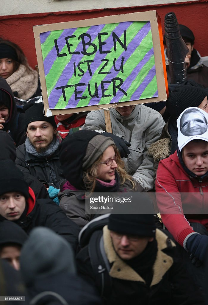 Protesters blockade the entrance to Lausitzer Strasse 8 to prevent the eviction of the German-Turkish Gulbol family hold a sign that reads: 'Life Is Too Expensive' on February 14, 2013 in Berlin, Germany. Several hundred protesters arrived to demonstrate in support of Ali Gulbol, his wife and two sons, who face eviction from their apartment in Kreuzberg district despite the fact that they invested EUR 20,000 into their apartment and have paid all their outstanding rent, albeit behind schedule. The case is highlighting an ongoing controversy over gentrification in parts of Berlin, where rising housing prices are luring investors and forcing long-standing tenants out.