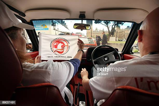 Protesters Bob Hills and Julie Gill drive in a convoy of Vauxhall cars around Parliament Square in Westminster in a campaign to safeguard workers'...