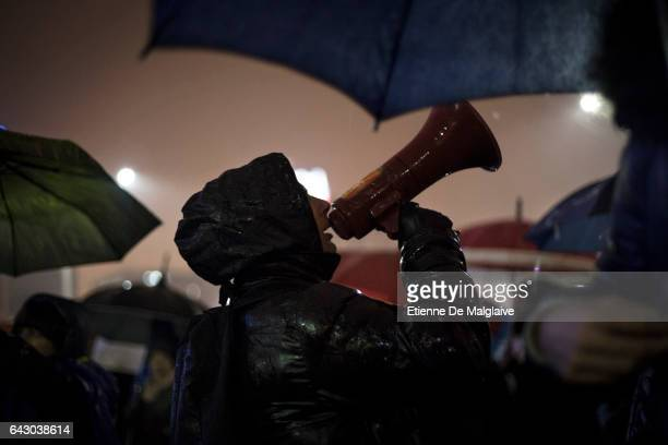 Protesters braving the rain gather in front of the government headquarters at the Victory square demanding resignation of PM Sorin Grindeanu Romania...