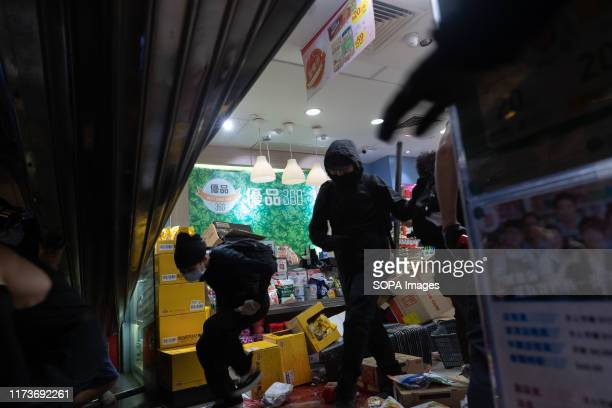 Protesters break in 360 small progovernment super market during a demonstration in Hong Kong Night of violence with protesters across city comes...