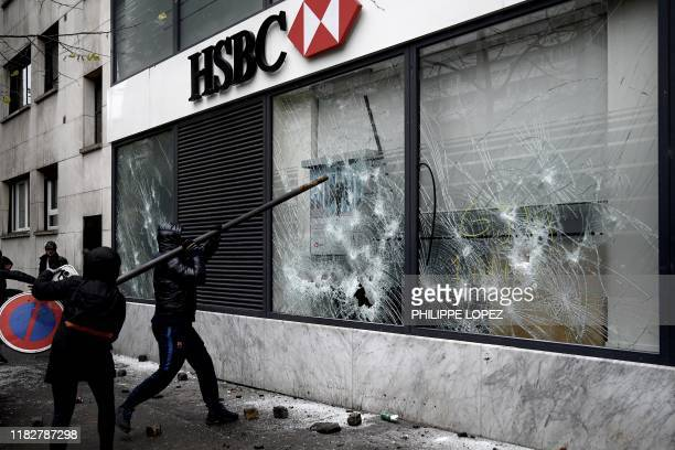 Protesters break the windows of a bank near the Porte d'Italie in Paris on November 16 during clashes on the sidelines of a demonstration marking the...