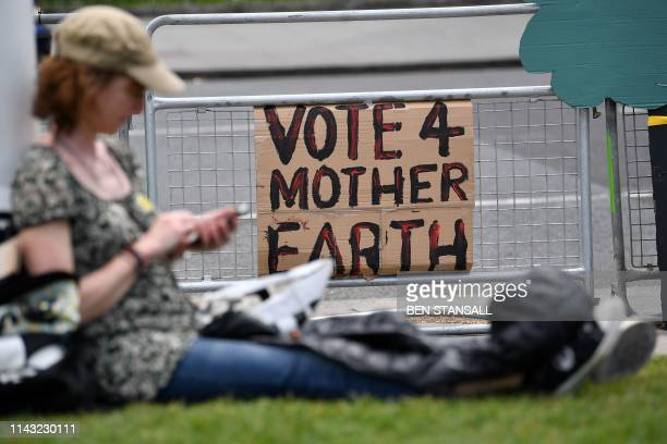 Protesters bring placards as they gather for a march calling for action to combat climate change organised by the climate campaign group Mothers Rise...
