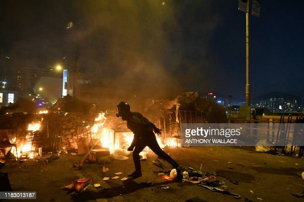 TOPSHOT Protesters build a fire outside the Hong Kong Polytechnic University during clashes with the police in Hong Kong on November 17 2019 Hong...