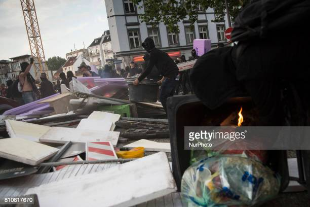 Protesters build barricade during riots in St Pauli district during G 20 summit in Hamburg on July 8 2017 Authorities are braced for largescale and...