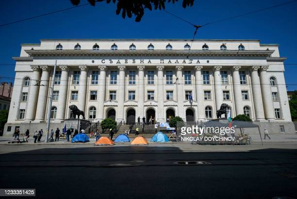 Protesters build tents at the entrance of the Palace of Justice during a protest against Bulgaria's chief prosecutor, in Sofia, on June 9, 2021. -...
