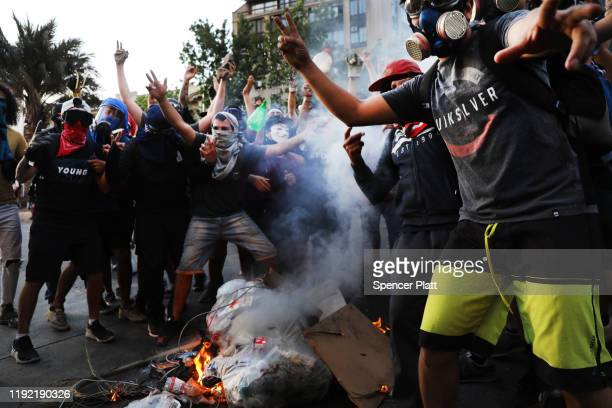 Protesters burn a barricade in downtown Santiago as demonstrations continue against Chilean President Sebastian Piñera on December 05 2019 in...