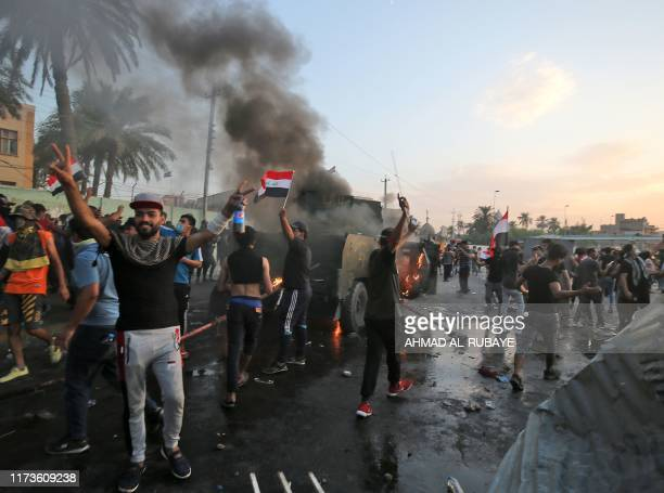 Protesters burn a riot police vehicle during clashes amidst demonstrations against state corruption failing public services and unemployment in the...