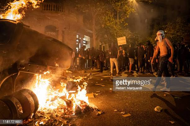 Protesters burn a trash bin as they take to the streets to demonstrate after the Spanish Supreme Court sentenced nine Catalan separatist leaders to...