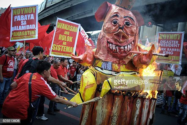 Protesters burn an effigy depicting President Aquino during a demonstration outside the presidential palace in Manila Philippines November 30 2013...