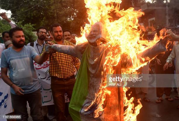 Protesters burn an effigy of Indian Prime Minister Narendra Modi during a protest in Lahore on August 16 2019 The United Nations Security Council is...