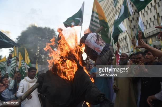 Protesters burn an effigy of India's Prime Minister Narendra Modi during a rally against the recent sectarian violence in India's capital over the...