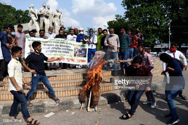 Protesters burn an effigy of the Israeli Prime Minister Benjamin Netanyahu during the demonstration. Bangladeshi Muktijuddho Moncho protest against...
