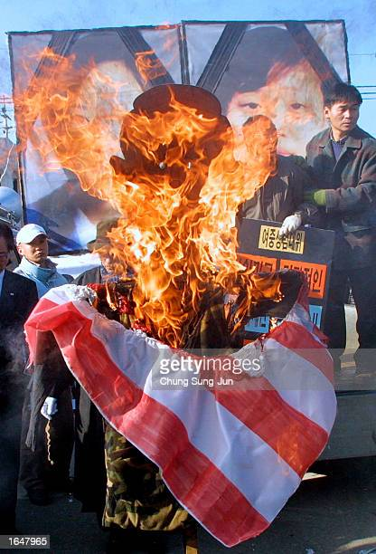 Protesters burn an effigy of US President George W Bush during an antiUS demonstration at Camp Casey November 18 2002 in Uijongbu north of Seoul...