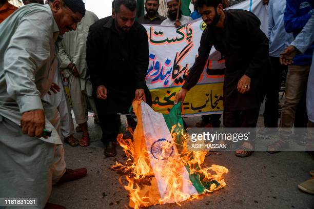 Protesters burn an Indian flag during a protest in Karachi on August 15 as the country observes 'Black Day' on India's Independence Day over the...