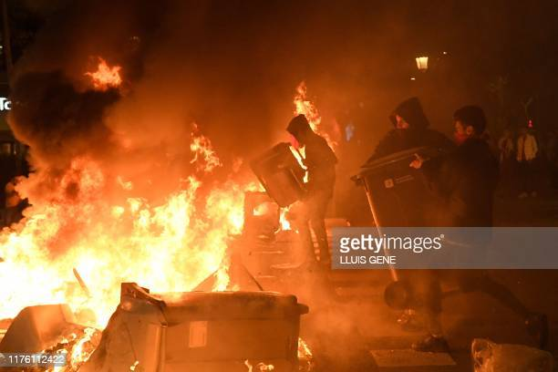 TOPSHOT Protesters burn garbage containers during protests in Barcelona on October 15 as Catalonia geared up for more upheaval a day after thousands...